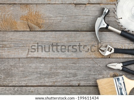 Set of tools on wood panel background with copy space - stock photo