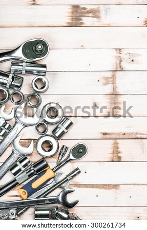 Set of tools on wooden background - stock photo