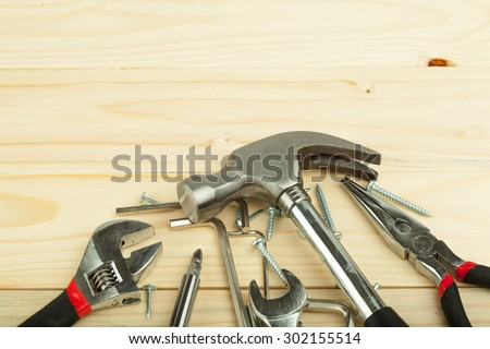 Set of tools over a wood background.