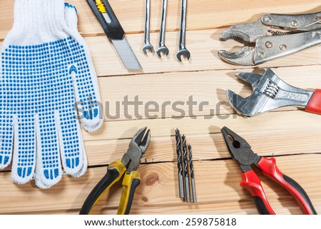 Set of tools over a wood panel with space for text. - stock photo