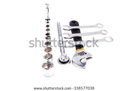 set of tools: ratche handle with bush's adjustable wrench and spanners - stock photo