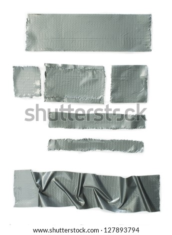 Set of torn gray masking Scotch tape isolated on white - stock photo