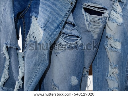 Set of torn jeans with wooden ladders