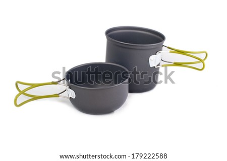 Set of tourist camping tableware with folding handles, isolated on white background  - stock photo