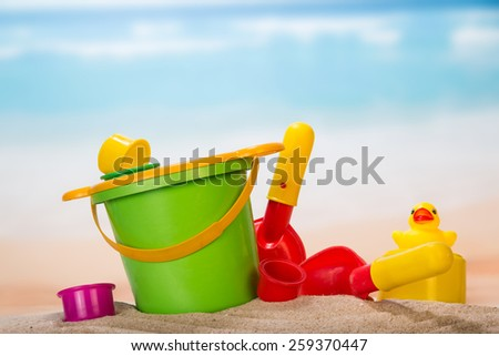Set of toys in the sand closeup