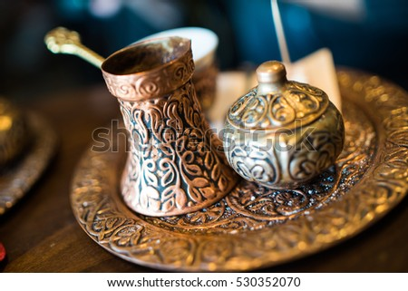 Set of traditional brass pottery for ritual coffee drinking. Ottoman Turkish style.