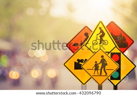 Set of traffic sign on blur road traffic background. Retro color style. - stock photo