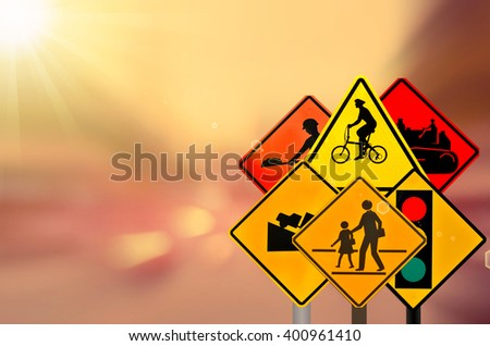 Set of traffic sign on motion blur road traffic background. - stock photo
