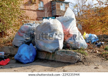 Set of trash bags with garbage outdoors in Astrakhan, Russia - stock photo
