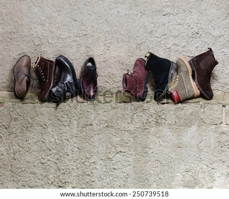 Set of trendy man footwear on a grunge background - stock photo