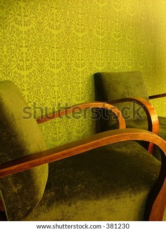 set of two cozy green armchairs in remarkably green room - stock photo