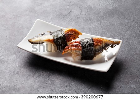 Set of unagi sushi on stone table