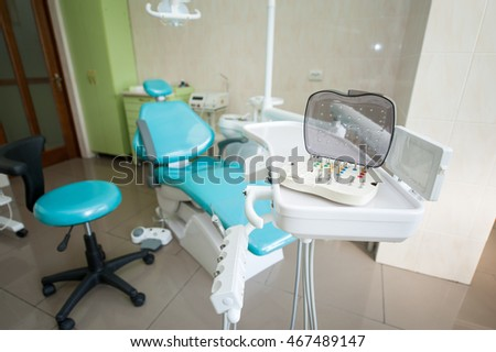 Set of variety of dental milling burs stands on the dental unit in dentist's office. Dentistry. Stomatology equipment