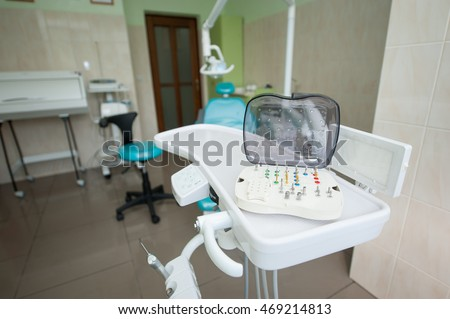 Set of variety of dental milling burs stands on the dental unit in stomatological clinic. Stomatological equipment
