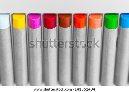 set of various color crayon for fabric in angle view