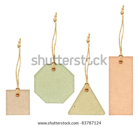 Set of various grungy aged pastel color paper tags with metal rivets and simple traditional strings, isolated on white background - stock photo