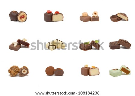 Set of various hand-made candies from dark, white and milk chocolate with different fillings. - stock photo