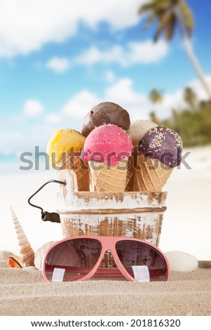 Set of various kind of fruit ice cream on wooden deck with blur sea on background - stock photo