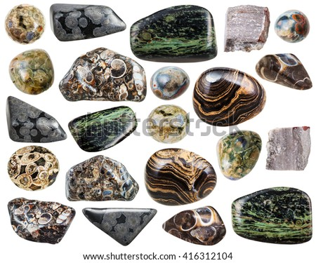 set of various natural rhyolite mineral stones and gemstones isolated on white background - stock photo