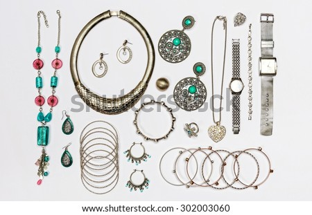 Set of various silver jewelry, isolated on white background.Top view. - stock photo