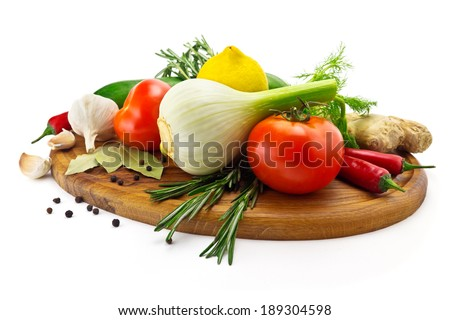 set of vegetables Vegetables on a white background garlic, fennel, rosemary, tomatoes, pepper, ginger on a cutting board - stock photo