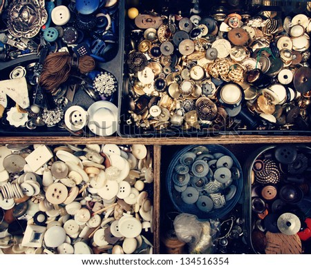 Set of vintage buttons in old wooden box, flea market - stock photo