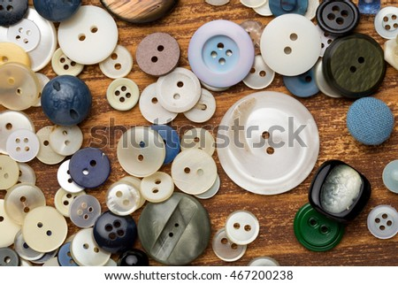 Set of vintage buttons on old wooden table