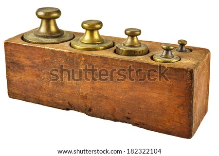 Set of vintage copper measurement weights in a wooden box isolated on a white background - stock photo