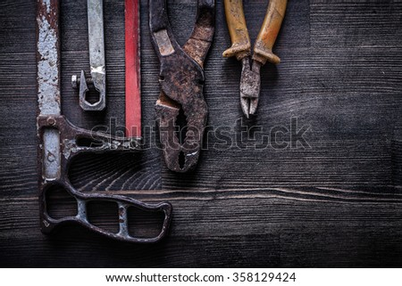 Set of vintage handsaw wire-cutter pliers construction concept. - stock photo