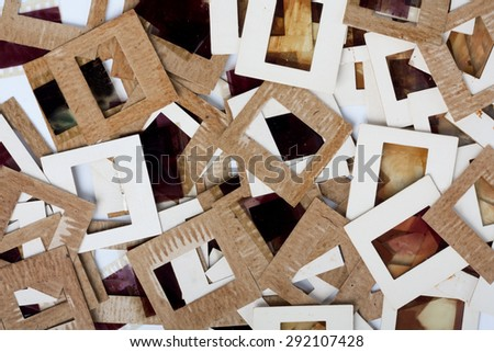 Set of vintage old slides, photos and film on the table - stock photo