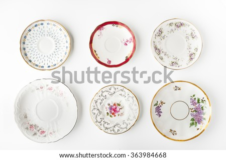 Set of vintage plates on the white background - stock photo