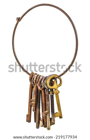 Set of vintage rusty keys hanging on a ring isolated on a white background - stock photo