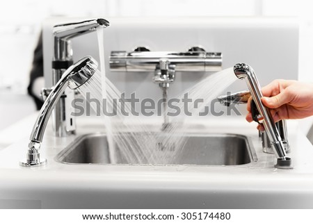 set of water mixing faucets - stock photo