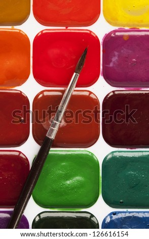 set of watercolor paints and brushes for painting - stock photo