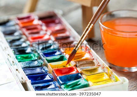 set of watercolor paints and for painting closeup selective focus