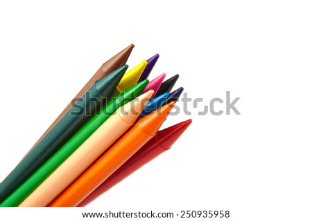 Set of wax crayons pointing up isolated on white background - stock photo