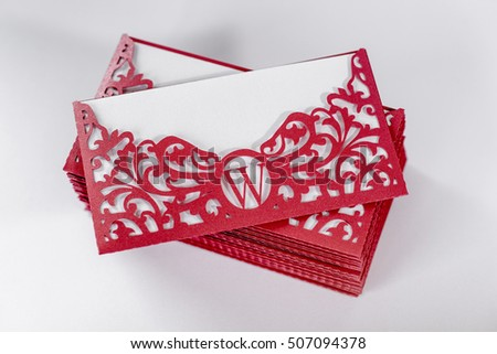 Set of wedding invitations. Carved envelope red and white design of the liner paper.