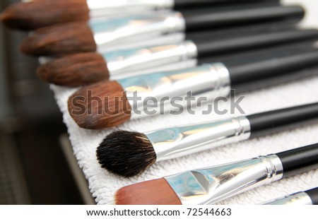 Set of wet make-up brushes, drying on white towel
