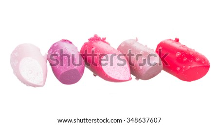 set of wet pink lipsticks isolated on white background