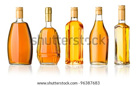 Set of whiskey bottles isolated on white background - stock photo