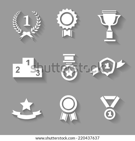Set of white  award  success and victory icons with trophies  stars  cups  ribbons  rosettes  medals medallions  wreath and a podium on grey