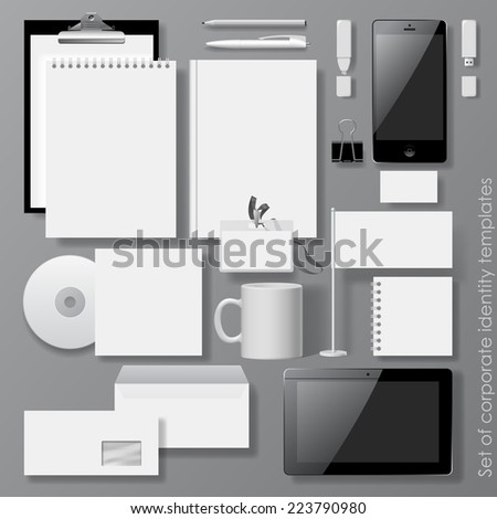 Set of white design corporate identity templates with notepad, envelope, business card, CD, Mobile phone, Tablet computer, flag, badge, mug  and other office accessories.  - stock photo