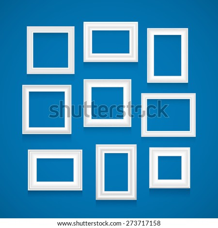 Set of white picture frames on blue wall. Raster version. - stock photo