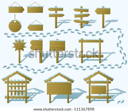 Set of wood board billboards and signs under winter snow