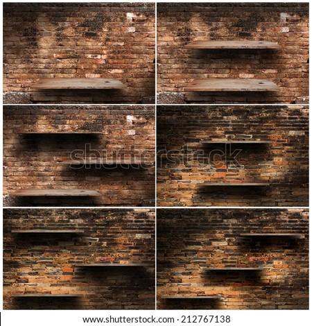 set of wood shelf on brick wall - stock photo