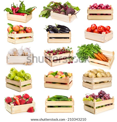 Set of wooden boxes with vegetables, fruits and berries isolated on white background - stock photo