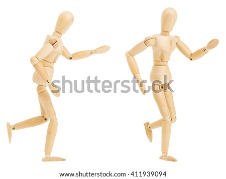 set of wooden figure in running pose in two position on white background