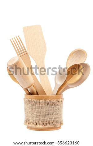 Set of wooden kitchen utensils isolated on white background. - stock photo