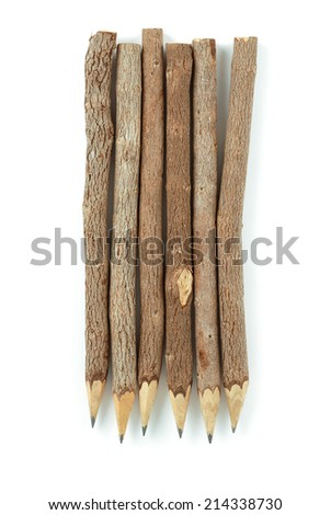 Set of wooden log pencils made of branches - handmade art supplies isolated on white background craft object lead sharpen drawing branch design cool  draw twig crayons creativity architect artistic - stock photo