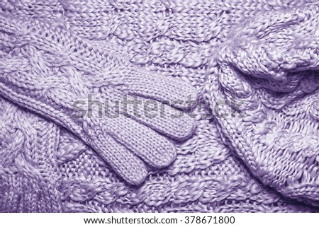 Set of Wool sweater or scarf, hat and gloves texture close up. Knitted jersey Fabric background with relief pattern. Braids in machine knitting pattern. Wool hand-knitted or machine knitting pattern. - stock photo